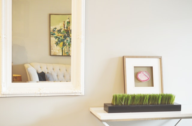 Placing mirror in your living room will make it looks more spacious