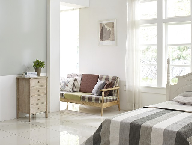 bedroom with wood furniture and stripe view also leaf picture wall decor