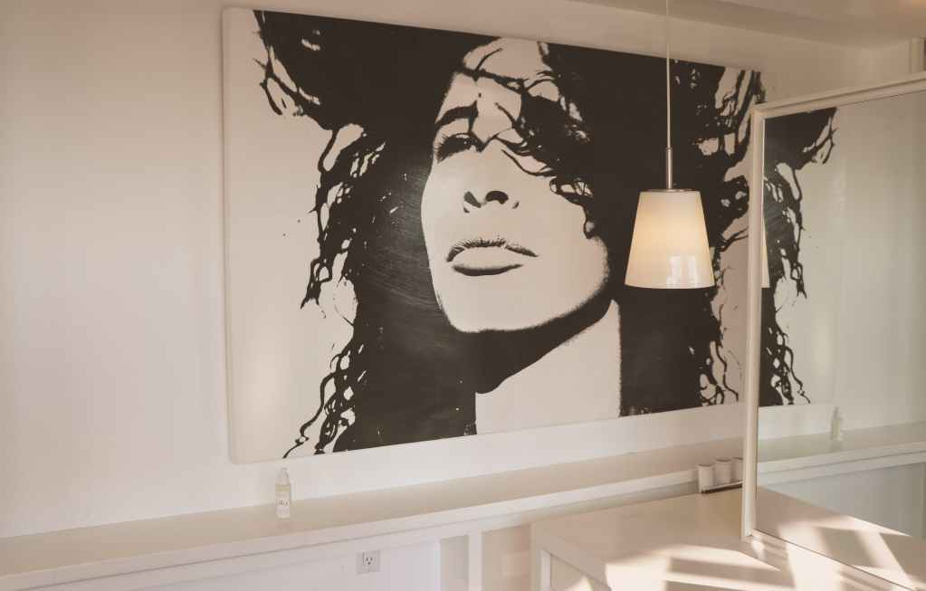 woman face painting on wall for living room decor