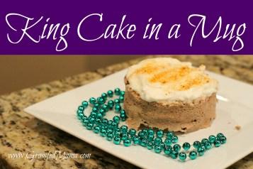 king cake banner in a mug