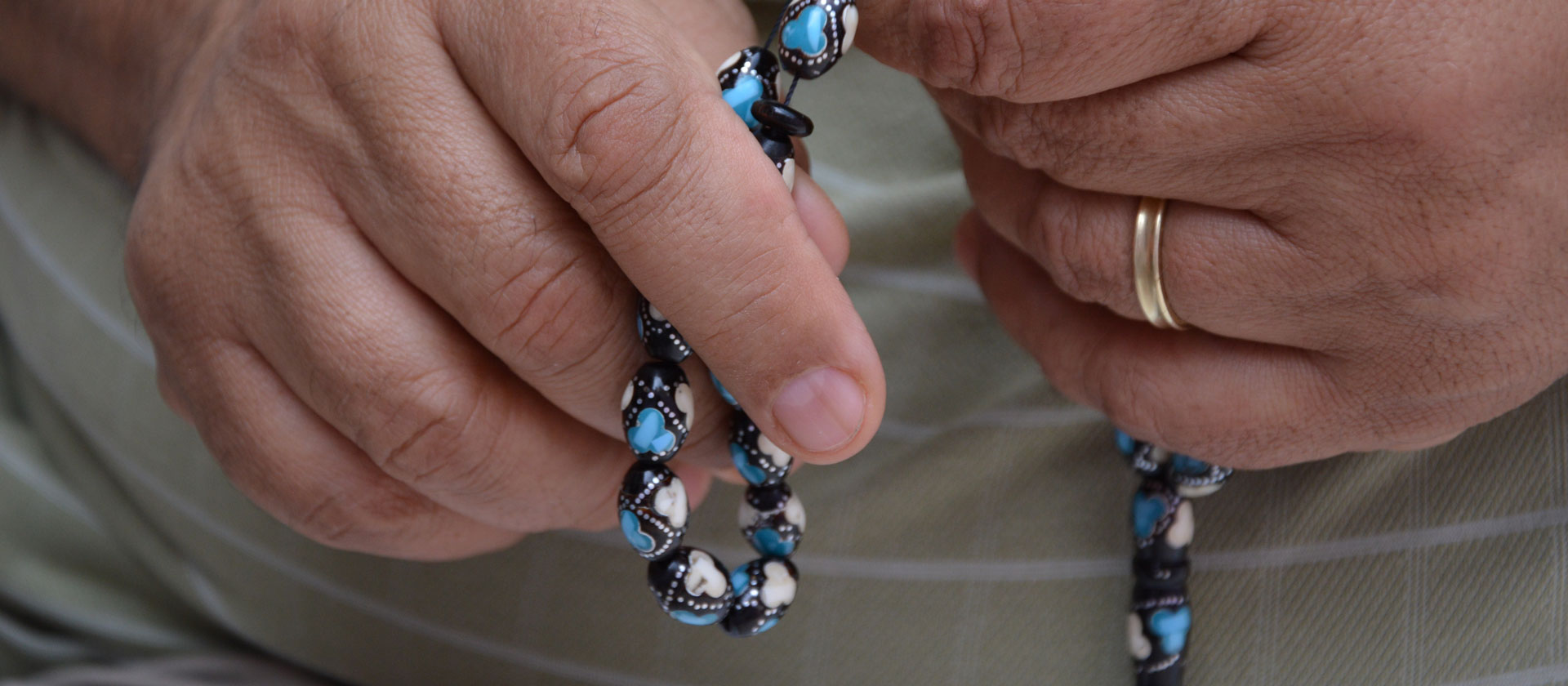 Hands praying rosary