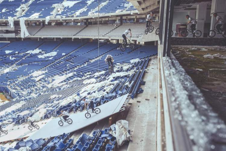 Tyler Fernengel performs a massive 360 barspin inside the abandoned Silverdome Stadium during Red Bull Resurrection in Pontiac, Michigan, USA, on 14 May, 2015.
