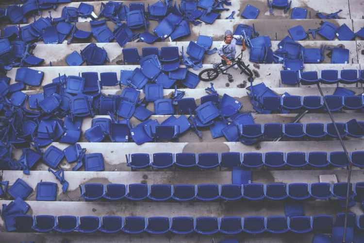 Tyler Fernengel in the sea of half-destroyed seats inside the abandoned Silverdome Stadium during Red Bull Resurrection in Pontiac, Michigan, USA, on 11 May, 2015.