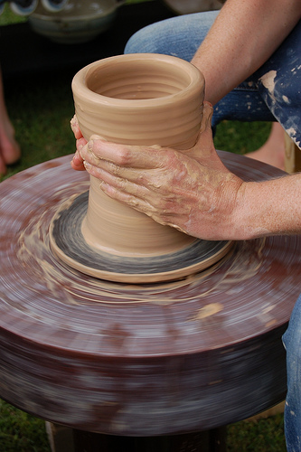 A closeup of a pottery vase in the process of being made