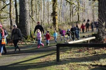 yule log celebration kids pulling log