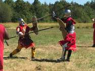 zach miller in armor fighting in field