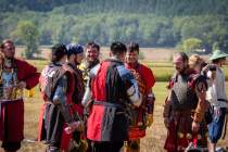 zach miller with group in armor