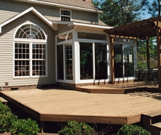 Deck Vs Patio Pros And Cons Of Each | Patio With Stairs From House | Residential | Curved Paver | Main Entrance Stamped Concrete Front | Walkout Basement | Decorative