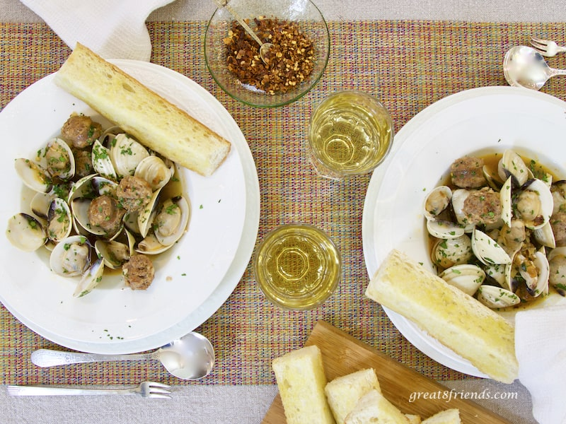 Clams with Hot Italian Sausage for two, overhead shot with wine and pepper flakes and bread