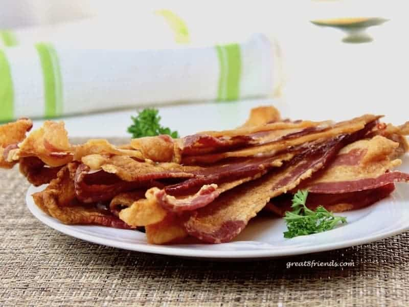 This is the best way to cook bacon for a crowd. Do you love to entertain? Cook your bacon in the oven! It's easy to make a lot at once and the clean-up is a breeze!