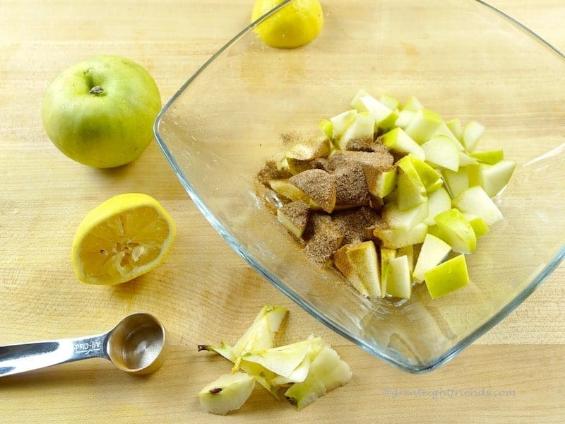 diced apples with spices on top.