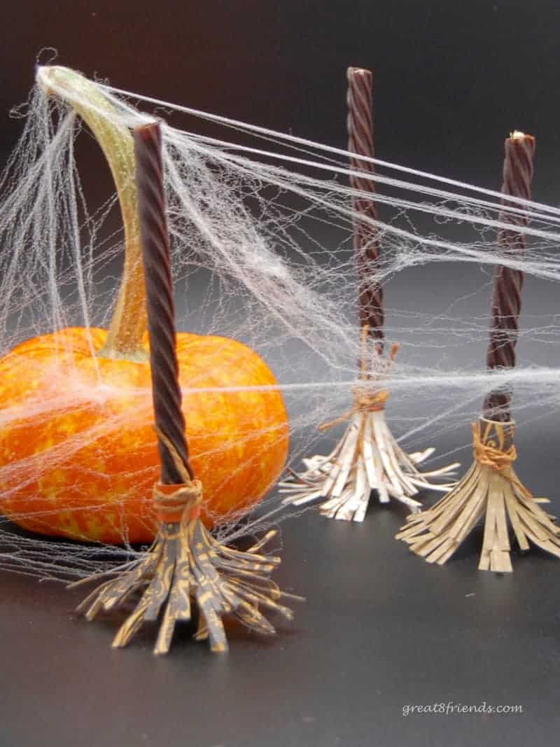 Cute and Crafty candy idea for Halloween. Dress up your Red Vines into Sweet Witch's Brooms! So fun and easy. Find out how right here!