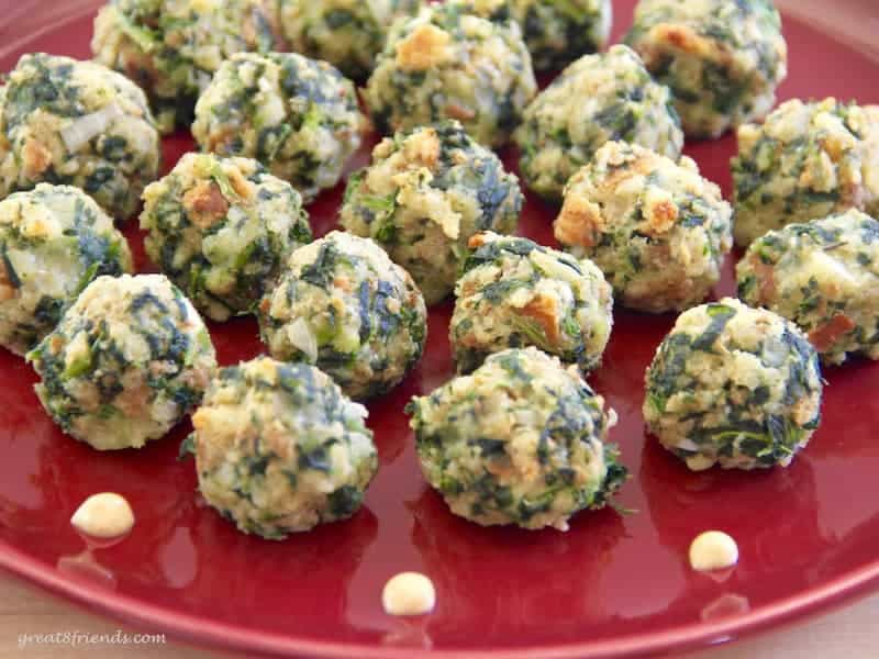 Super Simple Spinach Balls, the name says it all. Make these, freeze them, then you have the perfect appetizer ready to pop in the oven for any occasion.