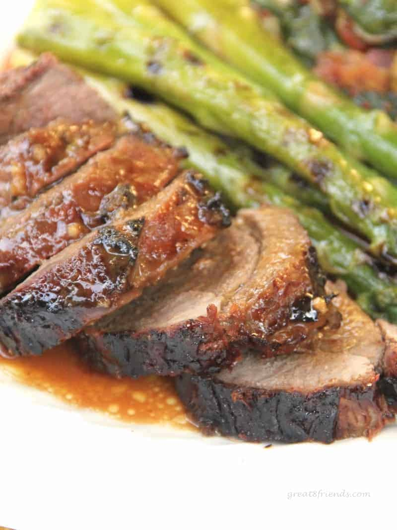 Butterflied, marinated, grilled and sliced leg of lamb served with grilled asparagus.