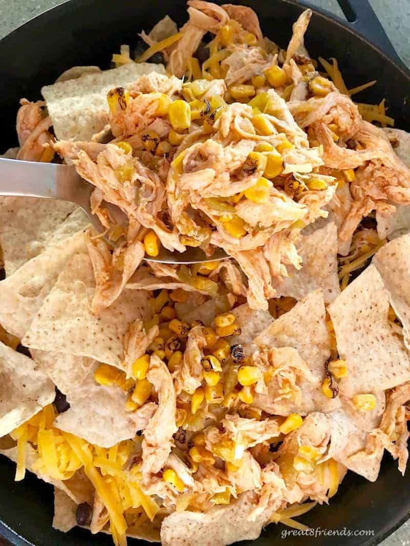 You will love these Nacho Typical Nachos! The addition of chicken and the buffalo nacho sauce make this appetizer perfect for any crowd!