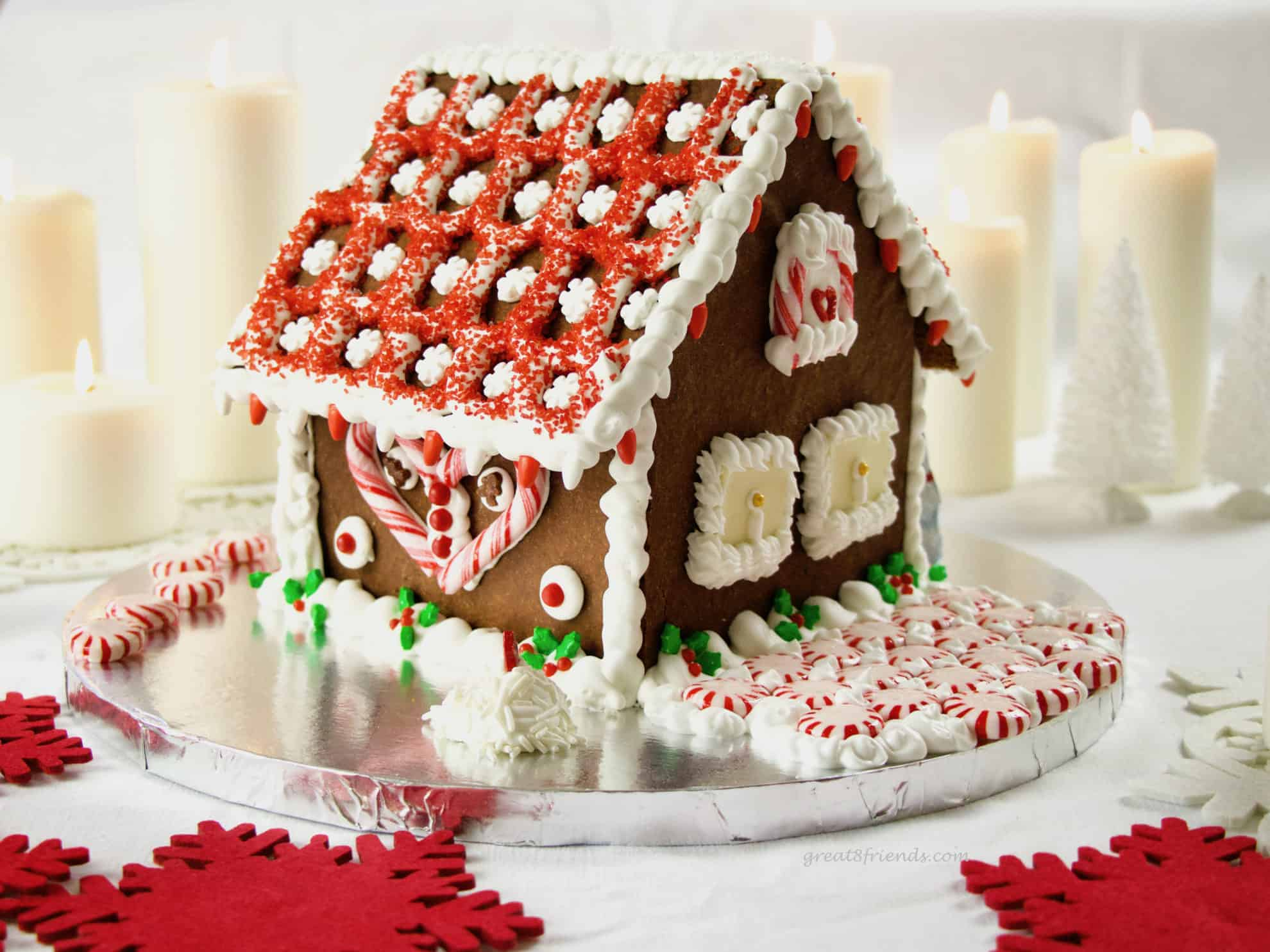 Don't buy a kit! Add whimsy and fun to your Christmas by making this DIY Festive Gingerbread House! We will show you how to make this edible decoration.