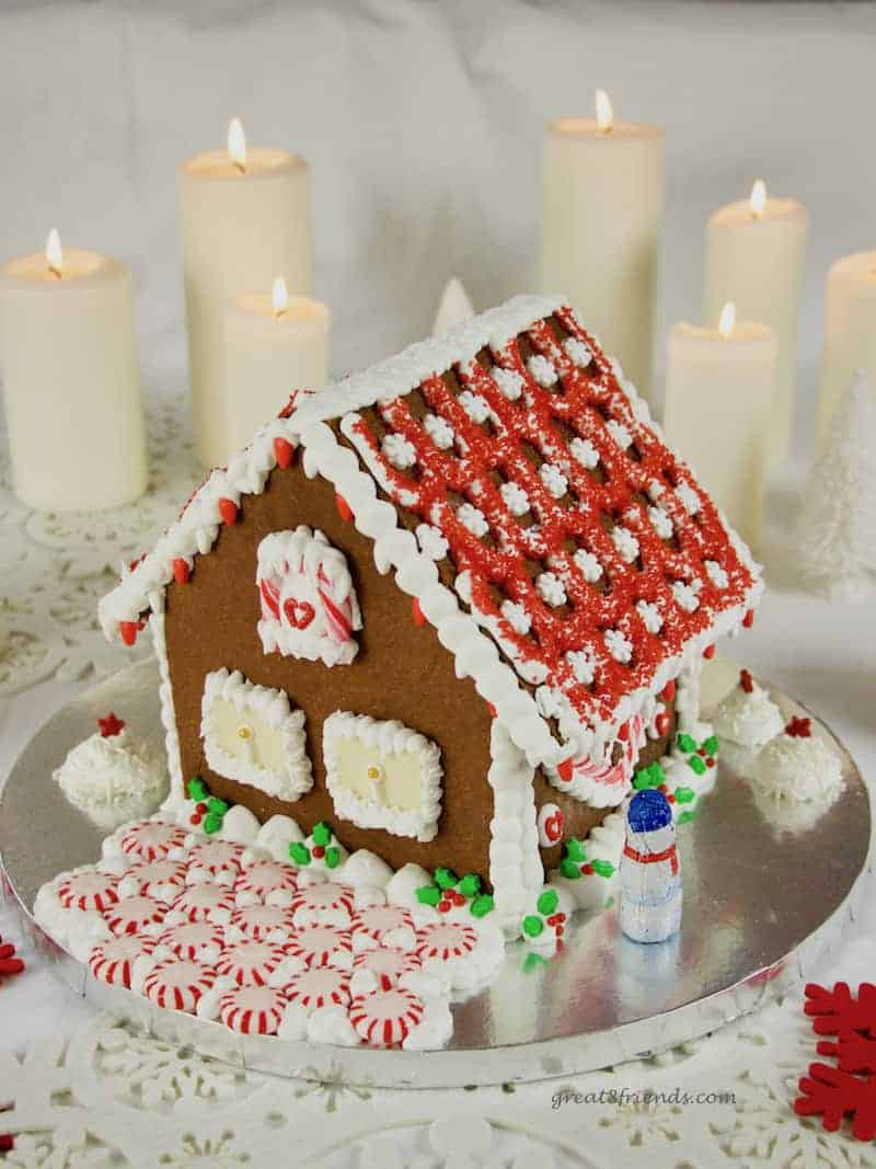 Don't buy a kit, add whimsy and fun to your Christmas by making this DIY Festive Gingerbread House! All the instructions right here.