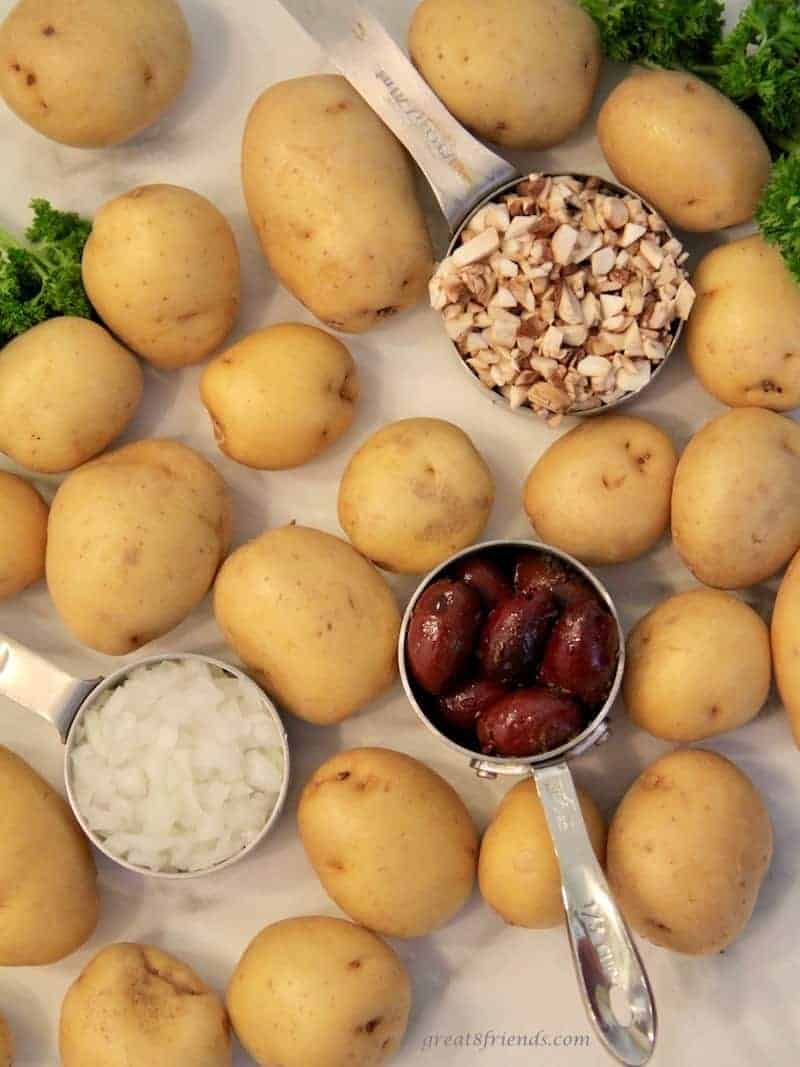 These roasted small new potatoes with a kalamata tapenade known as Dirty Potatoes are the perfect side dish for any meal.