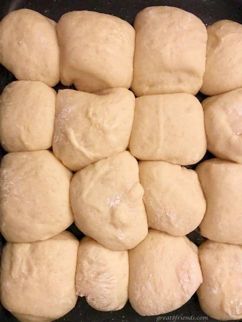 Hawaiian Bread Rolls rising on a baking sheet before baking.