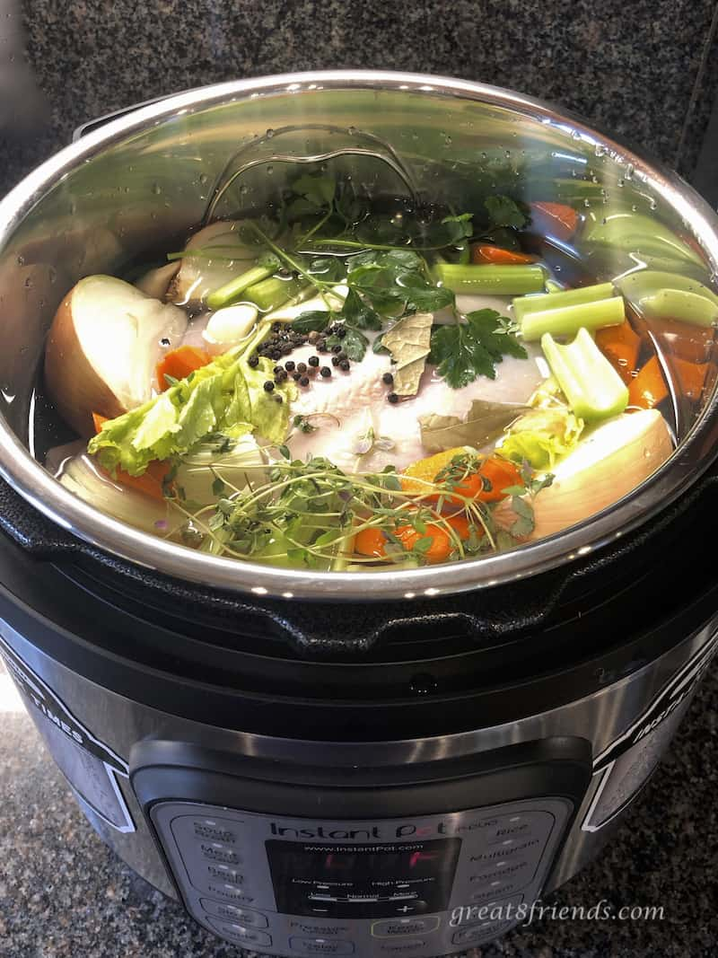 Chicken Stock ingredients in Instant Pot before cooking