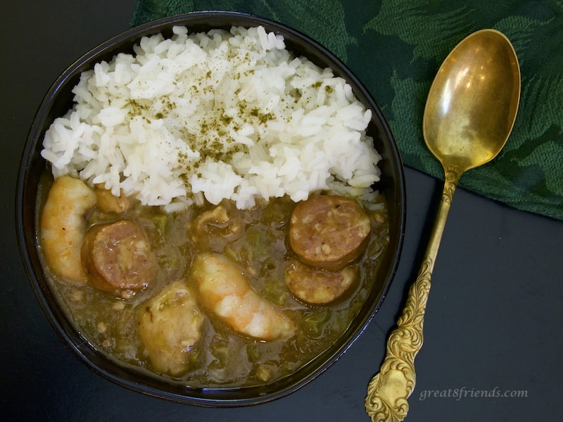 Sausage Shrimp and Chicken Gumbo with rice and gold spoon