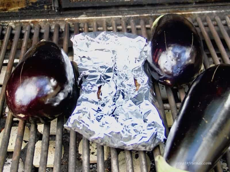 eggplants roasting on the bbq grill