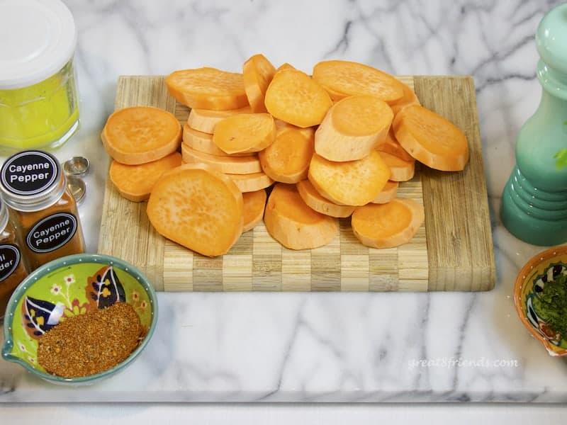 peeled sweet potatoes sliced into rounds.