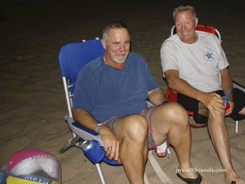 Joel and Tim sitting in beach chairs on the sand.
