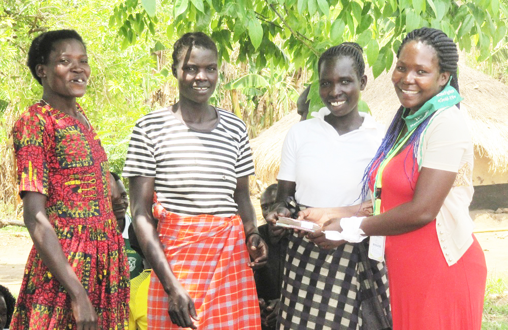 Toffister presenting loan to 3 other women.