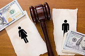 Gavel in between man and woman paper