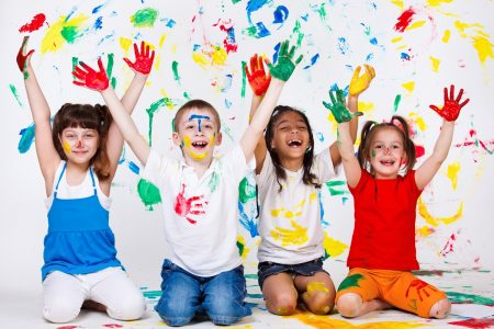 Kids with their palms and clothing painted