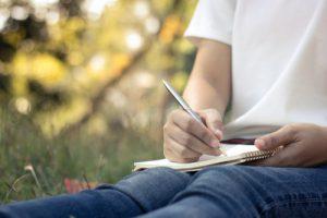 schrijven in notitieboek