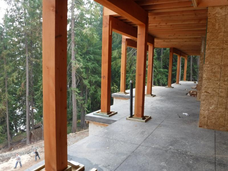 Thick fir posts and beams support the upper deck and roof.