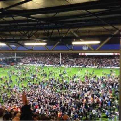 QPR fans on the pitch at Loftus Road