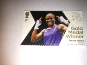 GB Gold Medalist Boxer Nicola Adams postage stamp shows her smile