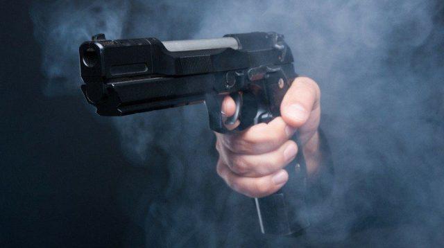 Holding and Firing Gun Pistol