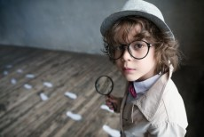 child dressed as detective