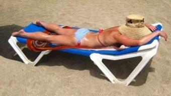 Woman lying on the beach in Palma Nova