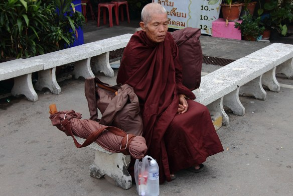 Buddhist monk in silent prayer