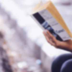 Blurry image of person reading book