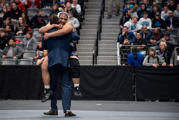GREELEY, CO - July 9: University's Emanuel Munoz-Alcala leaps to hug his coach after defeating Eaton's Tanner True in the 285 pound class 3A state final during the CHSAA High School State Wrestling Championships in the Pepsi Center in Denver Saturday, Feb. 22, 2020. Munoz-Alcala is one of eight wrestlers from the state to sign with the University of Northern Colorado. (Alex McIntyre/Staff Photographer)