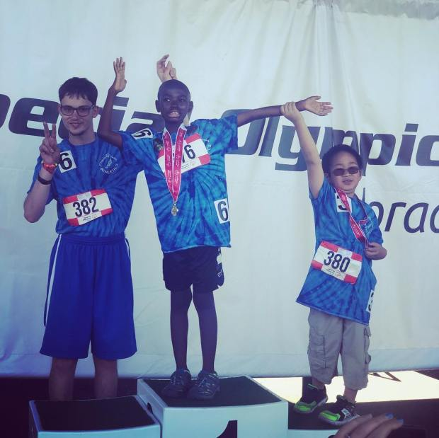 GREELEY, CO - August 30: Bryce Bowens, center, stands on the podium for the long jump at the 2019 Special Olympics at Colorado Mesa University. His father, University of Northern Colorado assistant football coach Tavares Bowens, hopes to use his new platform as a Division I assistant coach to share education about autism in honor of Bryce. (Courtesy of the Bowens family)