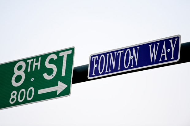 GREELEY, CO - SEPTEMBER 17:A sign signals the new street name during the surprise dedication ceremony of Tointon Way on 8th Street between 8th and 9th Avenues in downtown Greeley Sept. 17, 2020. Bob Tointon and his recently deceased wife Betty Tointon were instrumental in the development of downtown Greeley. (Alex McIntyre/Staff Photographer)