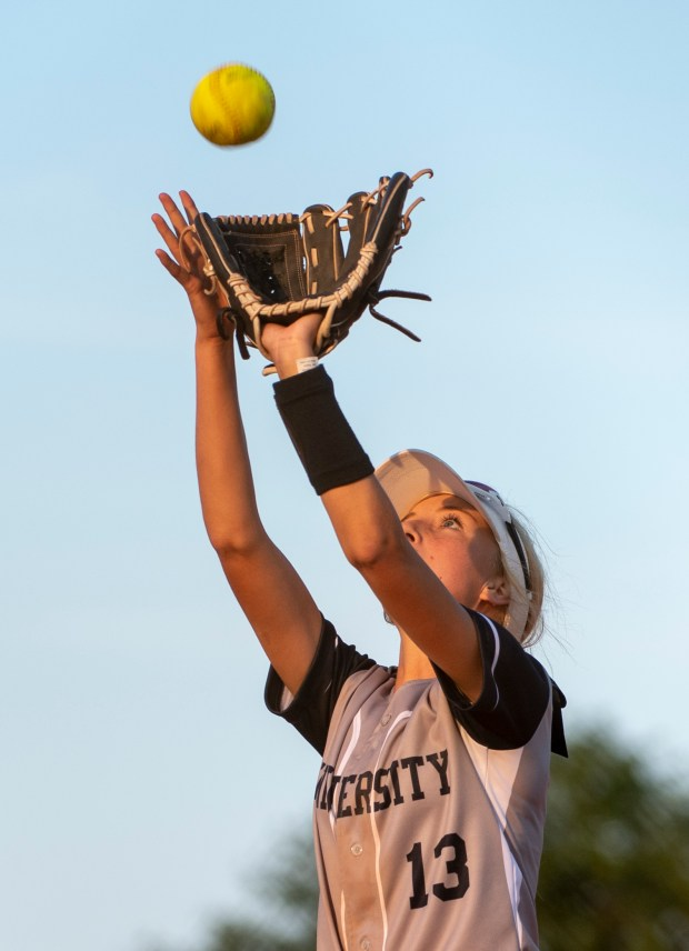 GREELEY, CO - SEPTEMBER 03:University centerfielder Kaden Wyatt (13) catches a fly ball during a softball game between the University Bulldogs and the Sterling Tigers at Twin Rivers Ball Fields in Greeley Sept. 3, 2020. The Tigers defeated the Bulldogs 6-4. (Alex McIntyre/Staff Photographer)