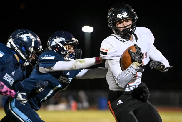 KERSEY, CO - OCTOBER 23:Platte Valley's Weston Meyer (11) shoves Sterling's Jackson Keil (6) out of bounds during the Platte Valley Broncos football game against the Sterling Tigers at Platte Valley High School in Kersey Oct. 23, 2020. The Broncos fell to the Tigers 31-21. (Alex McIntyre/Staff Photographer)