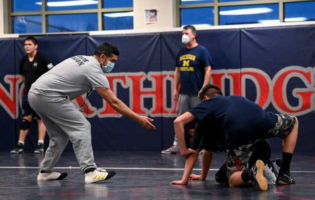 GREELEY, CO - JANUARY 21:Head coach Alfonso Aragon, left, directs his wrestlers during the Northridge Grizzlies wrestling practice at Northridge High School in Greeley Jan. 21, 2021. (Alex McIntyre/Staff Photographer)