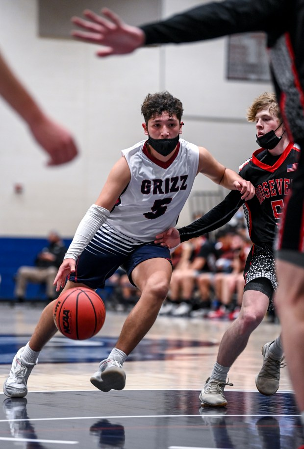 GREELEY, CO - FEBRUARY 09:Northridge's Miguel Rivera (5) drives down the court during the Northridge Grizzlies boys basketball game against the Roosevelt Roughriders at Northridge High School in Greeley Feb. 9, 2021. The Roughriders took down the Grizzlies 58-44.(Alex McIntyre/Staff Photographer)