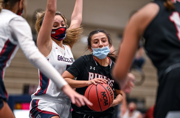 GREELEY, CO - FEBRUARY 09:Northridge's Seneya Martinez (5) defends Roosevelt's Jennessa Archuleta (15) during the Northridge Grizzlies girls basketball game against the Roosevelt Roughriders at Northridge High School in Greeley Feb. 9, 2021. The Grizzlies took down the Roughriders 58-53.(Alex McIntyre/Staff Photographer)