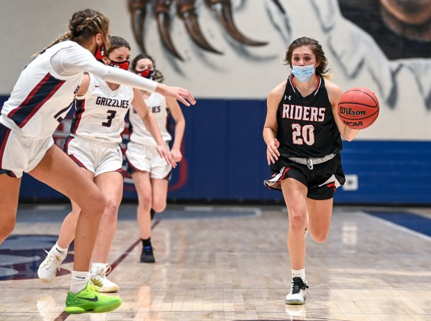 GREELEY, CO - FEBRUARY 09:Roosevelt's Trinity Ramirez (20) drives down the court during the Northridge Grizzlies girls basketball game against the Roosevelt Roughriders at Northridge High School in Greeley Feb. 9, 2021. The Grizzlies took down the Roughriders 58-53.(Alex McIntyre/Staff Photographer)