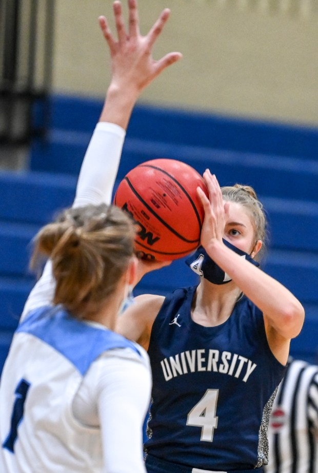 KERSEY, CO - FEBRUARY 13:University's Kylie Kravig (4) lines up her shot as Platte Valley's Andi Schissler (1) defends during the Platte Valley Broncos girls basketball game against the University Bulldogs at Platte Valley High School in Kersey Feb. 13, 2021. The Broncos defeated the Bulldogs 40-36. (Alex McIntyre/Staff Photographer)